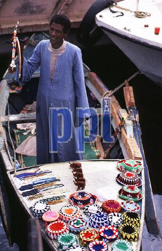 Souvenir trader on Nile Aswan Egypt