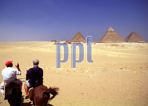 Camel riding in the desert Giza Egypt