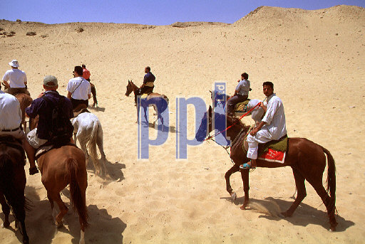 Camel riding in the desert Giza Egypt