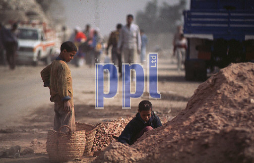 Children playing by worksite Cairo Egypt