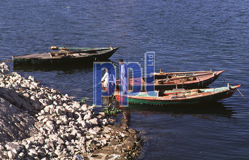 Local children playing on boats on the Nile Egypt