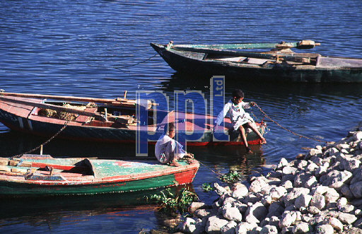 Local children playing on boats on River Nile Egypt