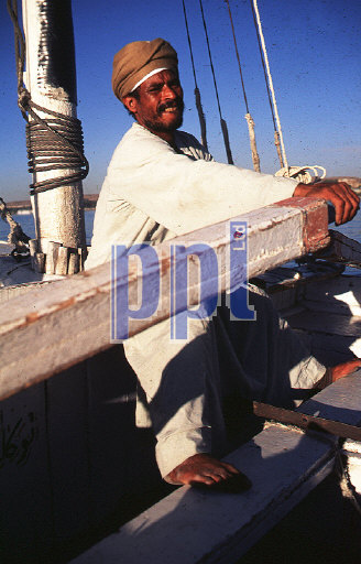 Local man rowing his felucca on the River Nile Egypt