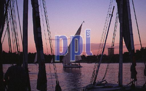 Felucccas on River Nile at sunset Aswan Egypt