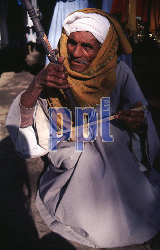 Old local street musician Edfu Egypt