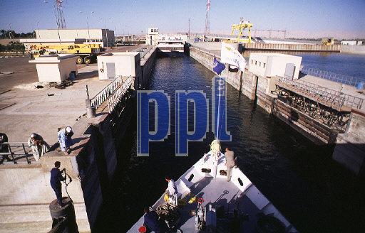 Cruise boat entering lock at Esna on the Nile Egypt