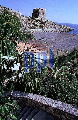Historic tower: beach, Almuneca, Spain